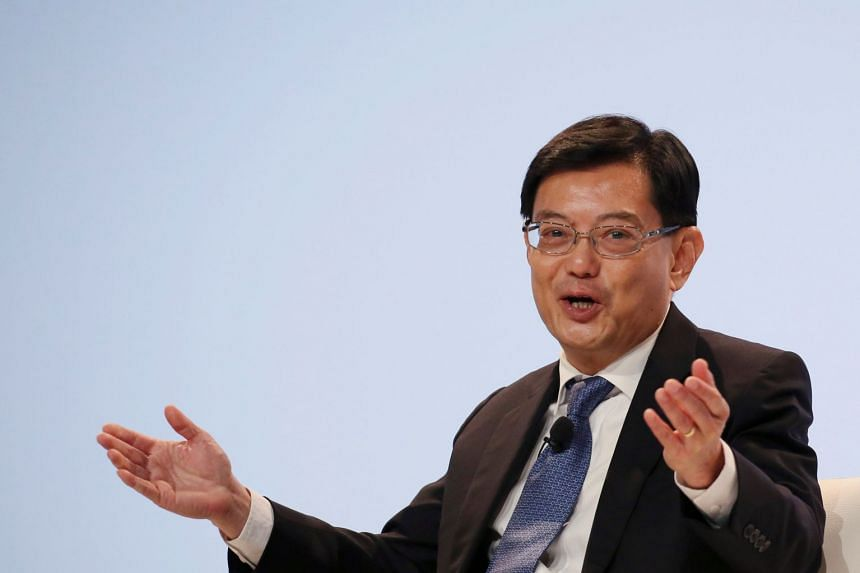 Trade tensions between the US and China are dampening global economic growth, said Mr Heng (above, in a file photo).