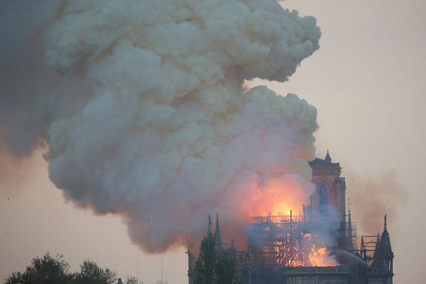 Smoke billows from Notre Dame Cathedral in Paris after a fire broke out.