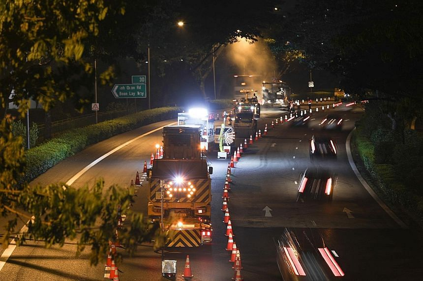 Road resurfacing on the PIE last Saturday. The resurfacing is being carried out from midnight to 4.30am to minimise traffic disruption. ST PHOTO: ONG WEE JIN