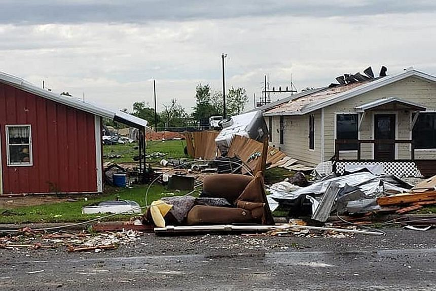 The aftermath of a tornado in Franklin, Texas, last Saturday. The storm system picked up strength in the southern US over the weekend, where it spurred tornadoes that killed at least five people, including three children, officials said.