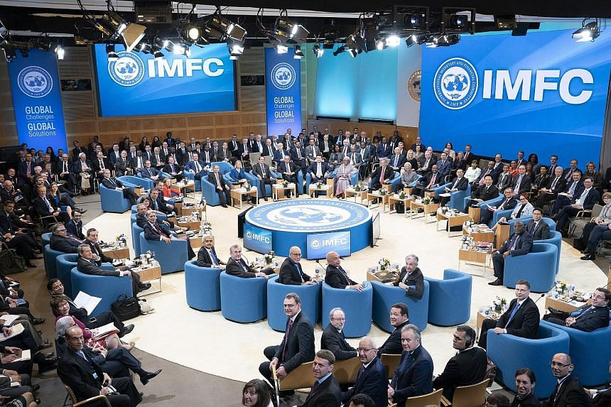 Members of the International Monetary and Financial Committee posing for a group photo at the start of their meeting at the IMF headquarters in Washington last Saturday, during the spring meetings of the IMF and World Bank.