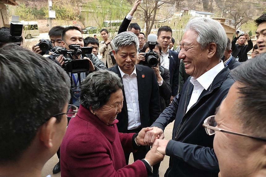 Singapore Deputy Prime Minister Teo Chee Hean interacting with villagers at Liangjiahe village, Yanchuan county, yesterday. The village is where Chinese President Xi Jinping spent seven years as a sent-down youth between 1969 and 1975 as the Cultural