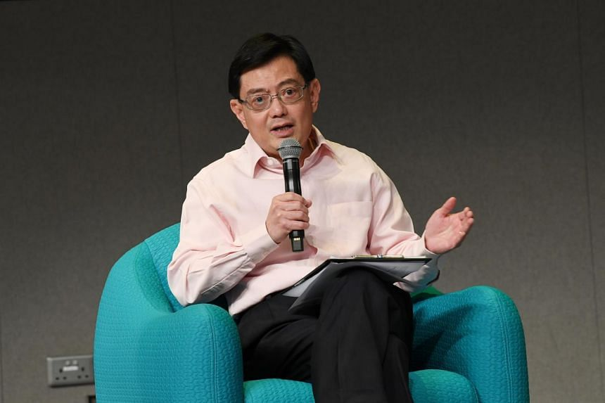 Finance Minister Heng Swee Keat said any dispute between the US and China should be resolved in accordance with international norms and through existing multilateral frameworks instead.