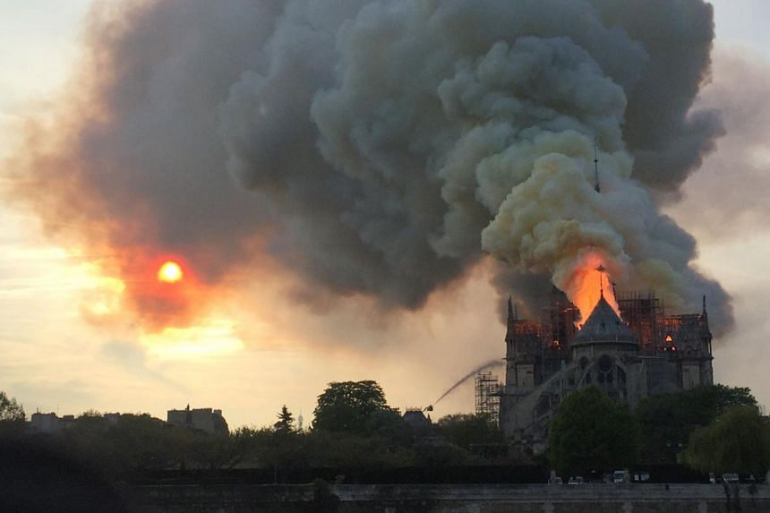 Flames and smoke seen billowing from the roof at Notre Dame Cathedral in Paris, on April 15, 2019.