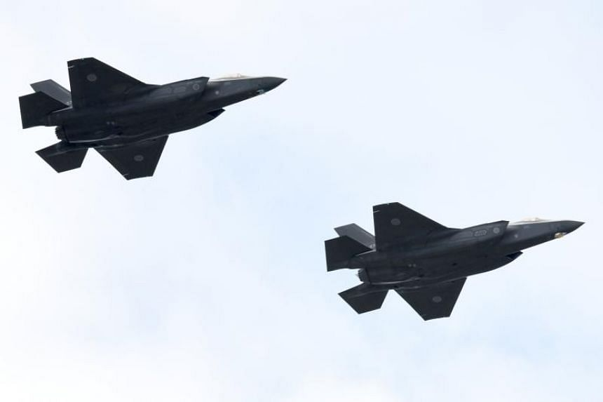 F-35A fighter aircraft from the Japan Air Self-Defence Force taking part in a military review at the Ground Self-Defence Force's Asaka training ground in Asaka on Oct 14, 2018.