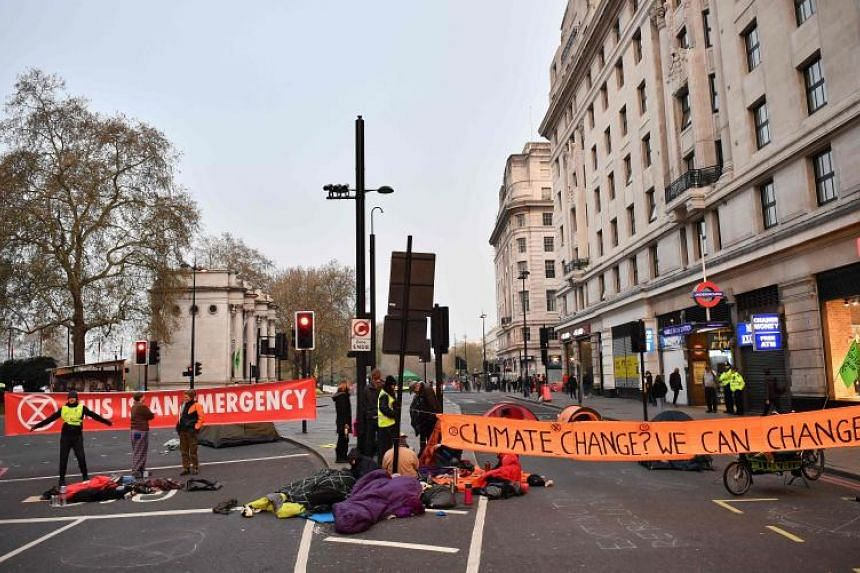 Activists block the road near Marble Arch on the second day of an environmental protest by the Extinction Rebellion group, in Londonon April 16, 2019.