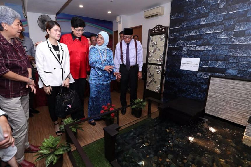 President Halimah Yacob looks at a water feature in Ain Society's newly launched cancer centre on April 16 at Block 9 Haig Road.