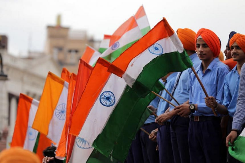 Students hold Indian flags as they take part in an event in Amritsar, India.