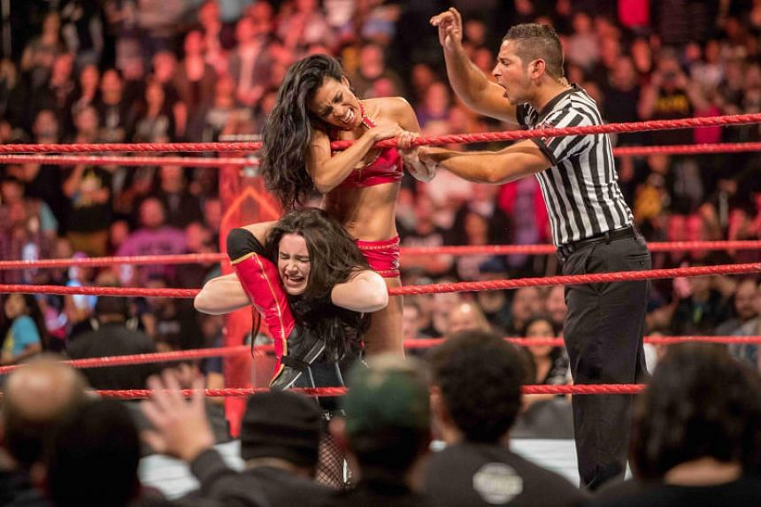 Fighting With My Family is about the Bevis family and their daughter Saraya-Jade, played by Florence Pugh (in black), who went on to become a success in America's WWE wrestling circuit.