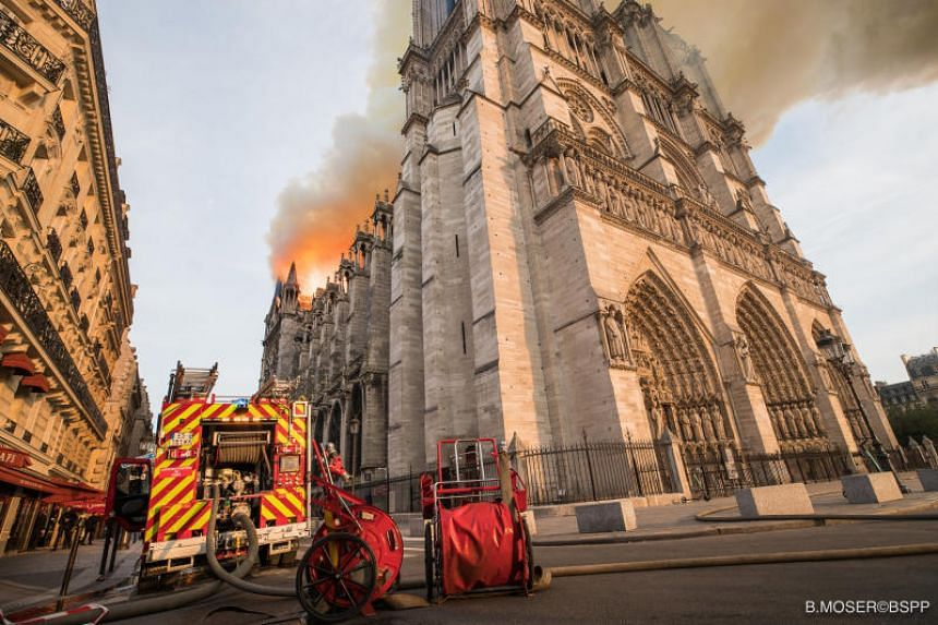 Paris fire brigade trucks are seen outside the Notre Dame Cathedral after a fire broke out, in Paris, France, on April 15, 2019.