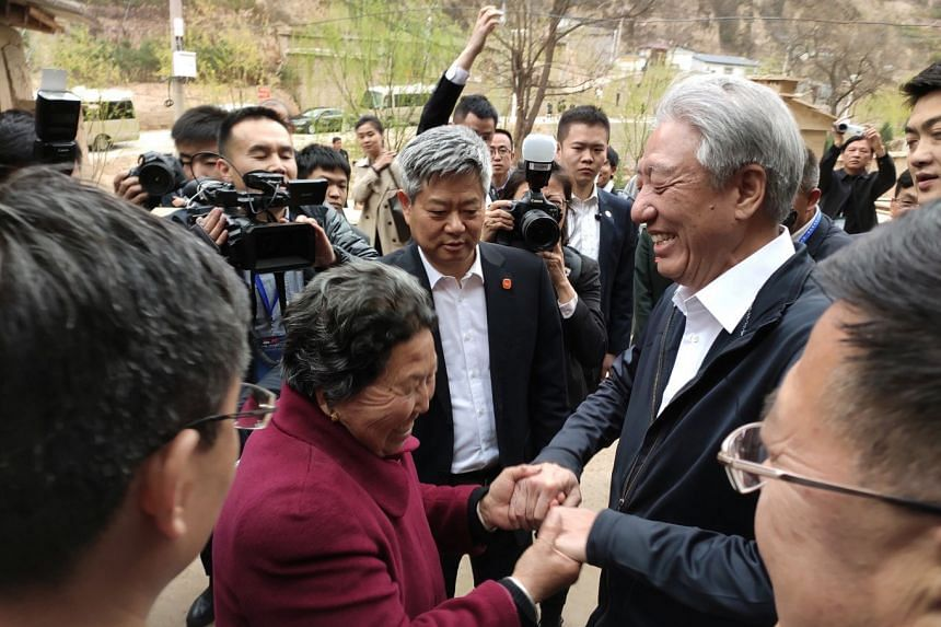 DPM Teo interacting with people in Liangjiahe village.