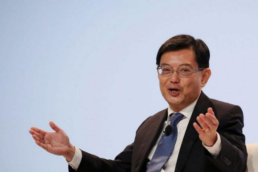 Trade tensions between the US and China are dampening global economic growth, said Finance Minister Heng Swee Keat.
