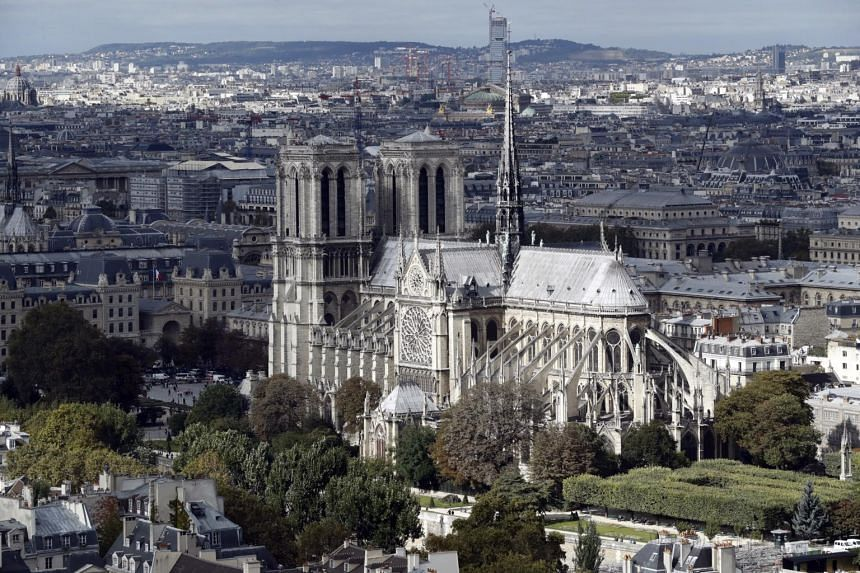 The Notre Dame cathedral is seen in Paris, France, on Sept 26, 2016. A fire started on April 15, 2019, at the roof of the cathedral.