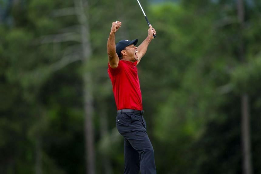 Tiger Woods reacts on the 18th hole after winning the Masters.
