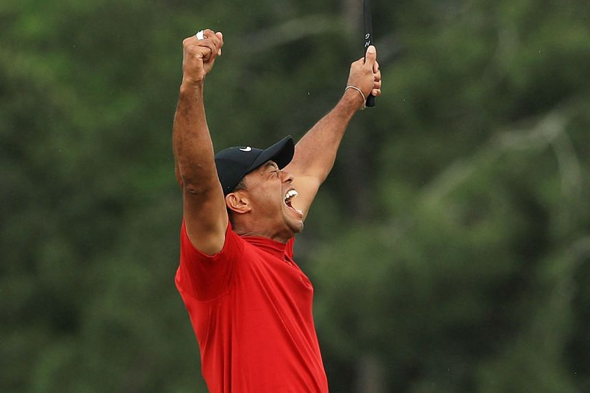 Tiger Woods shows his emotions after sinking his putt on the 18th green on Sunday at Augusta National Golf Club to win his fifth Masters title.