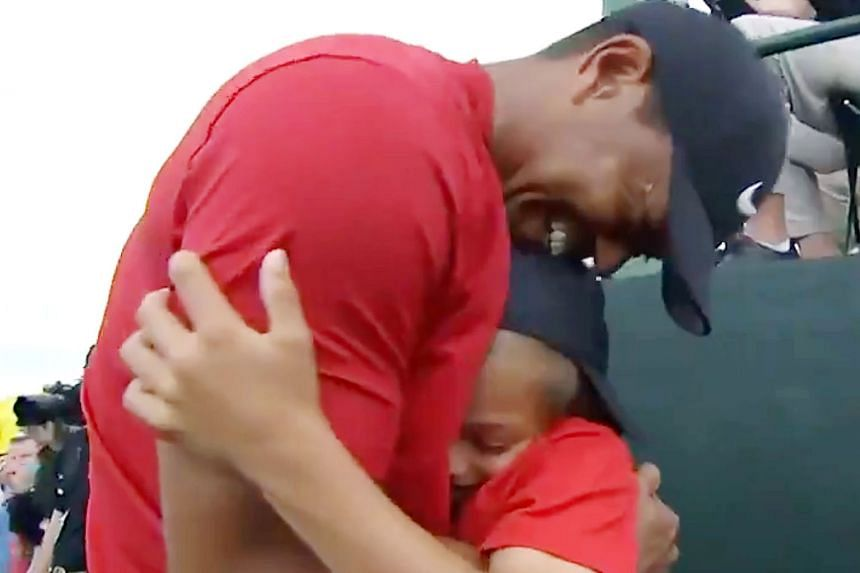 Left: Last year's champion Patrick Reed helping Tiger Woods put on the Green Jacket. Above: Soon after Woods won, he hugged his son Charlie at almost the exact spot he hugged his late father Earl (right) back in 1997 when Woods won his first Masters