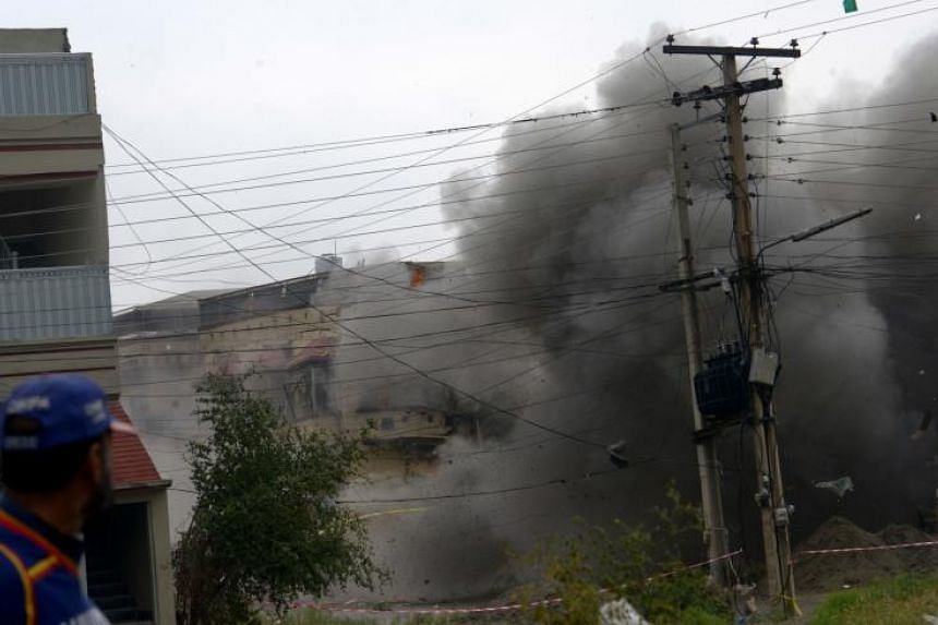 An explosion inside a hideout of suspected militants during an operation by Pakistani security forces in Peshawar on April 16, 2019.