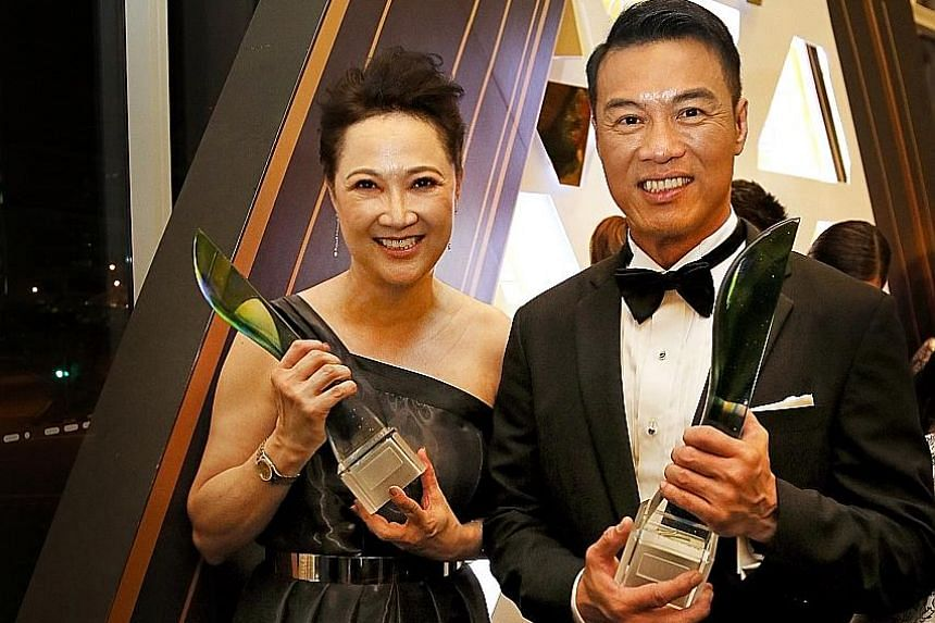 Actress Hong Huifang and her husband, actor Zheng Geping, at the Star Awards on Sunday with their awards for Top 10 Most Popular Female and Male Artistes.