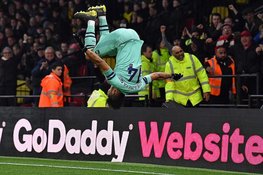 Arsenal's Gabonese striker Pierre-Emerick Aubameyang enjoying his trademark somersault after scoring in the English Premier League against Watford at Vicarage Road Stadium. It was the game's only goal. PHOTO: AGENCE FRANCE-PRESSE