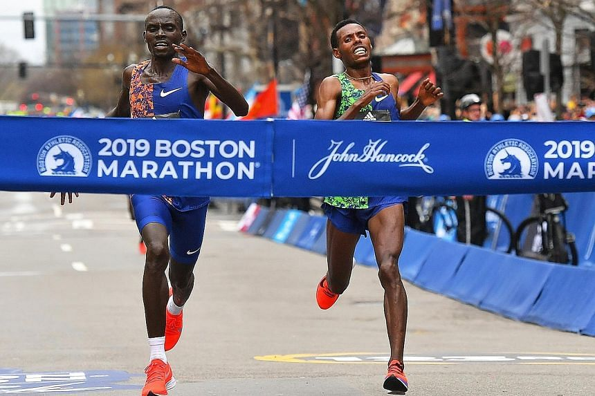 Lawrence Cherono of Kenya (left) beating Ethiopian Lelisa Desisa to the tape by just two seconds in one of the closest Boston Marathon finishes. Cherono's winning time on Monday was 2hr 7min 57sec. PHOTO: REUTERS