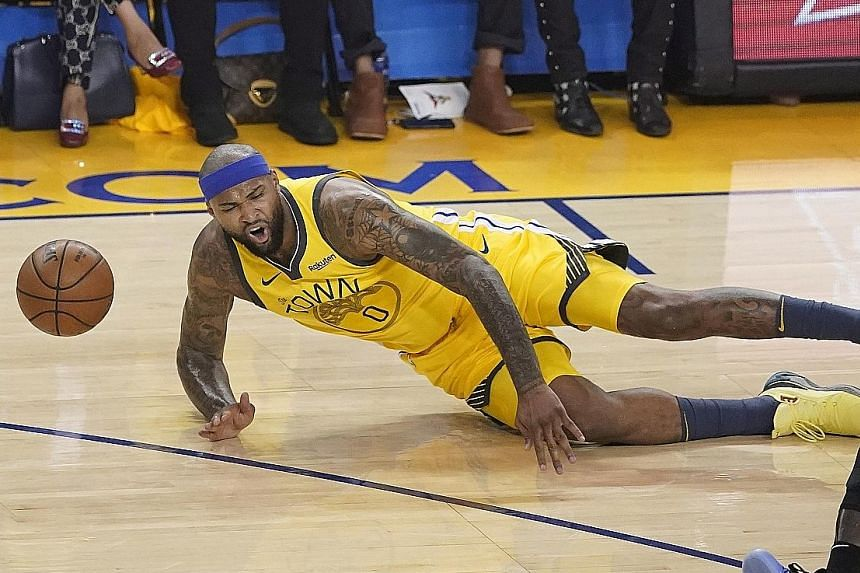 Warriors centre DeMarcus Cousins falling after injuring his left leg in the first half of the game. He was set to undergo an MRI scan yesterday. PHOTO: EPA-EFE