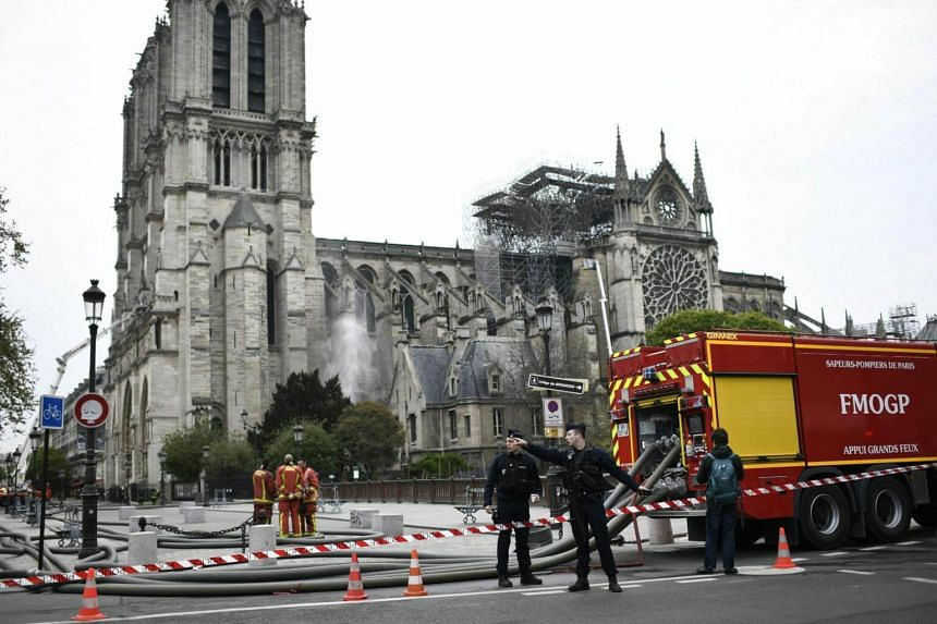 Firefighters continue to secure Notre Dame Cathedral in Paris, on April 16, 2019, in the aftermath of a fire that caused its spire to crash to the ground.