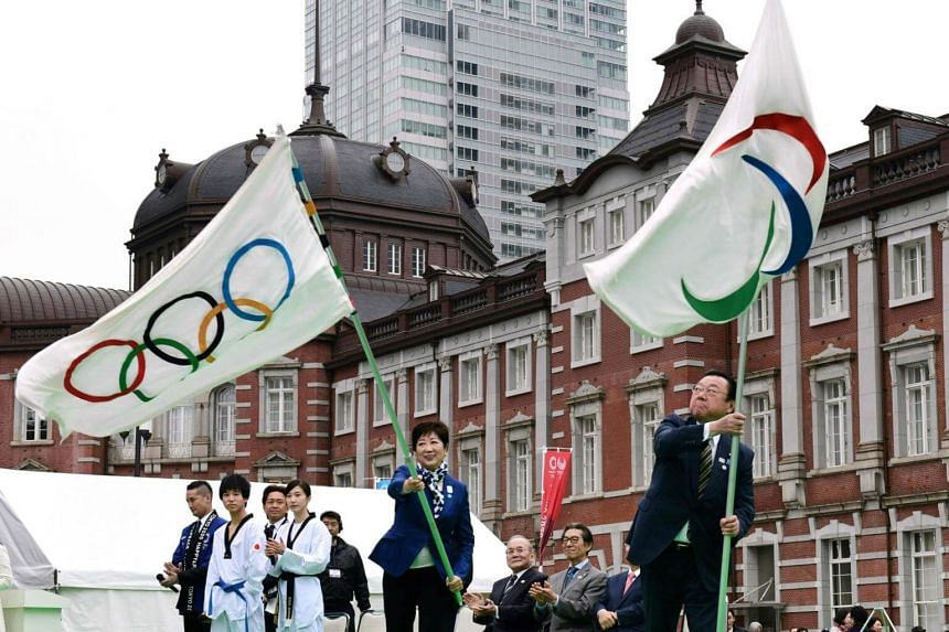 Tokyo Governor Yuriko Koike (centre) and Mr Yoshitaka Sakurada, Minister for the Tokyo Olympic and Paralympic Games, at the final event of the Tokyo 2020 Olympic Flag and Paralympic Flag Tour, on March 30, 2019.