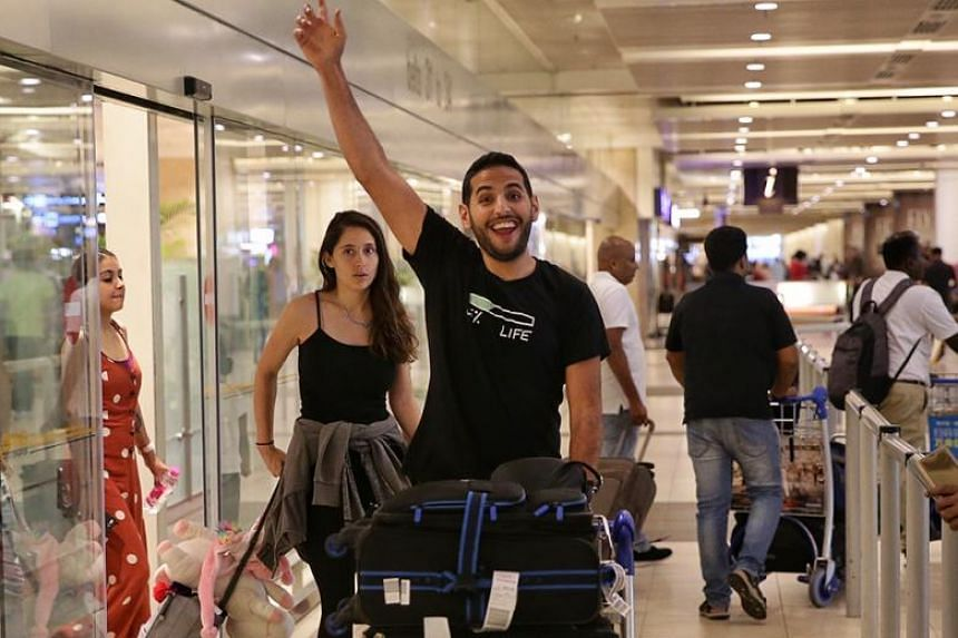 Nas Daily founder and travel vlogger Nuseir Yassin and his girlfriend Alyne Tamir arriving at Changi Airport Terminal 2 on April 17, 2019.