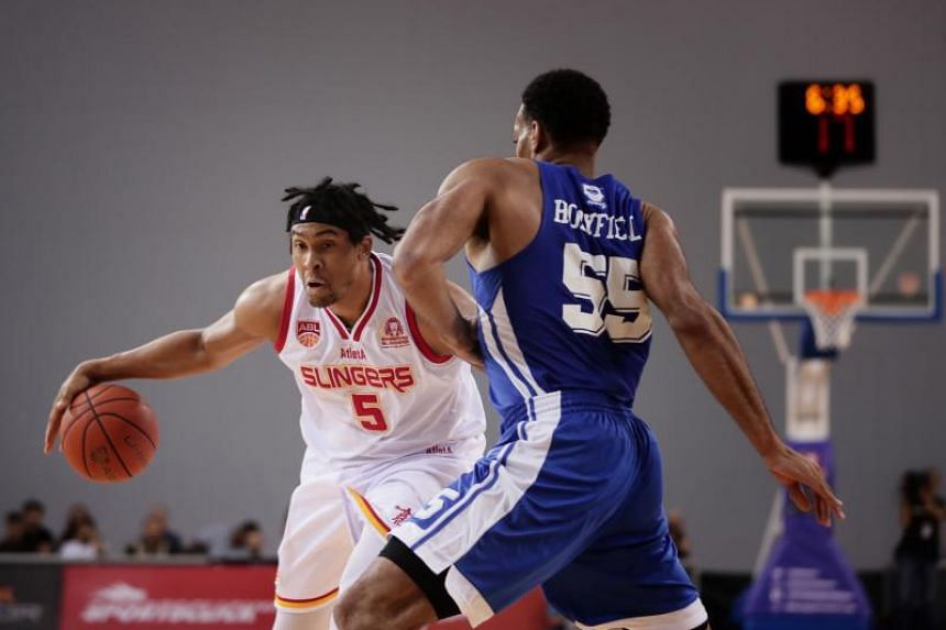 The Singapore Slingers' John Fields in action against Hong Kong Eastern 's Michael Kevin during Game 1 of their Asean Basketball League play-offs semi-final on April 12, 2019.