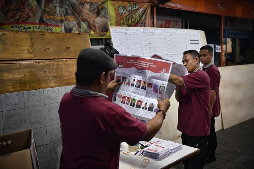 Indonesian election officials count ballots from the country's general election in Jakarta on April 17, 2019.
