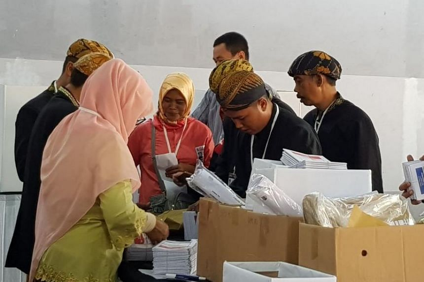 Officials counting ballot papers at a polling station in Bandung, Indonesia, on April 17, 2019.