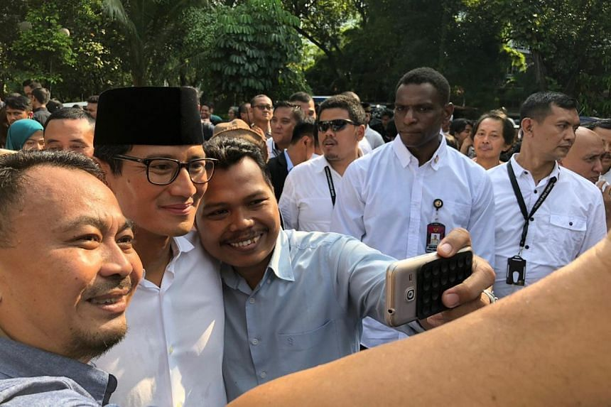Voters seizing the chance for selfies with presidential hopeful Prabowo Subianto's running mate Sandiaga Uno at a polling station in Jakarta.