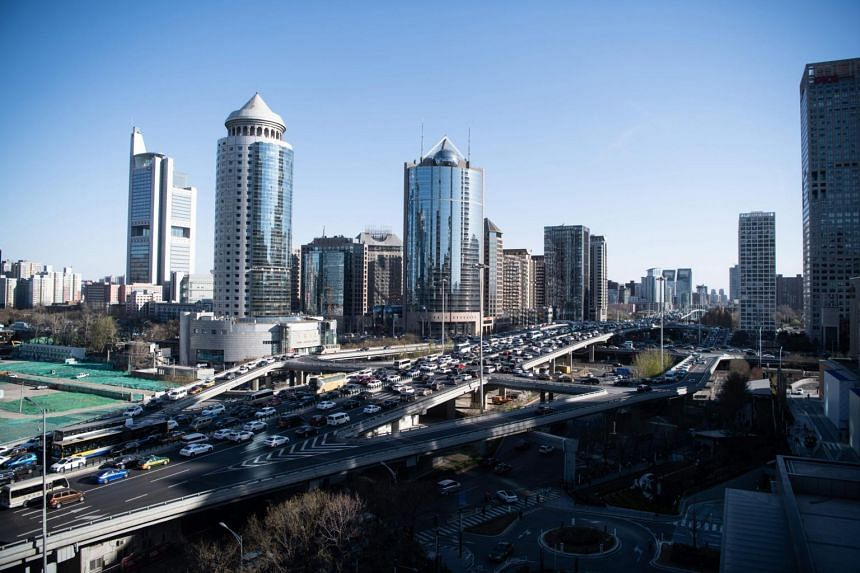 Traffic along a ring road in Beijing's central business district, on March 21, 2019.