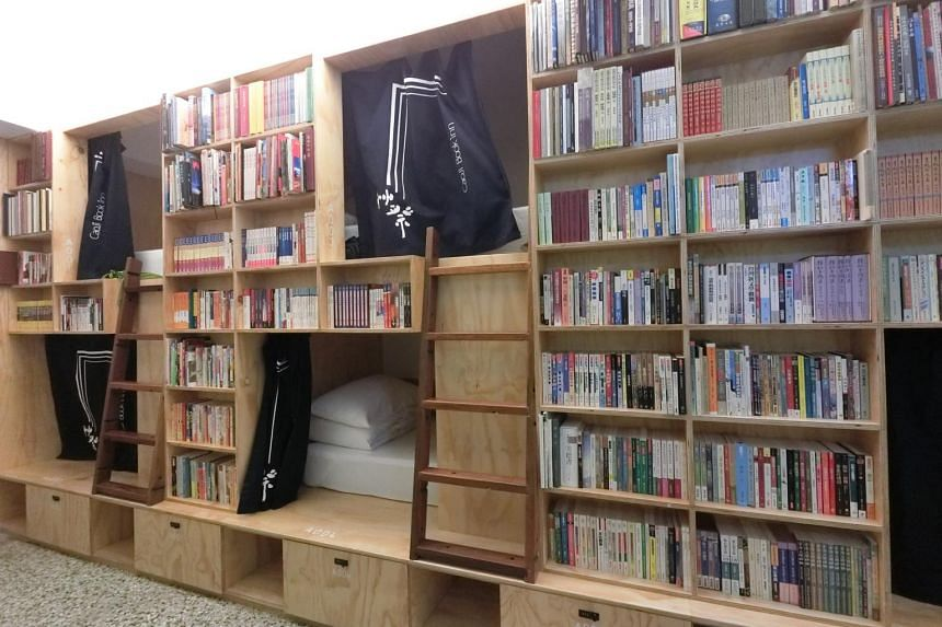 Caoji Book Inn has dormitory beds that are tucked into cosy bookshelf nooks.