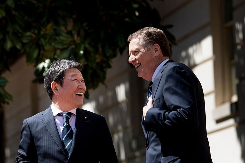 Japanese Economy Minister Toshimitsu Motegi and US Trade Representative Robert Lighthizer talk before a meeting at the US Trade Representative's office in Washington, on April 16, 2019.