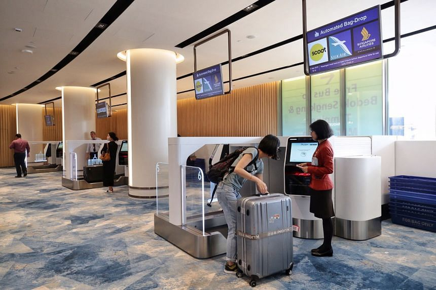 A traveller at the Early Check-in Lounge at Jewel Changi Airport, on April 17, 2019.