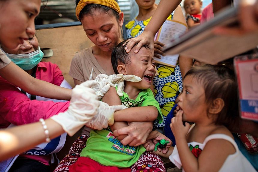 A child in Manila, Philippines, being vaccinated against measles in February. Several countries, including the Philippines, were hit by fresh measles outbreaks, the World Health Organisation said on Monday. So far this year, 170 countries have report