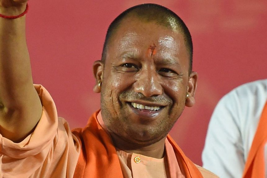 Uttar Pradesh Chief Minister Yogi Adityanath of the BJP is barred from campaigning for 72 hours for making religiously polarising speeches. An electrician testing LED-fitted boards with symbols of India's ruling Bharatiya Janata Party and the main op