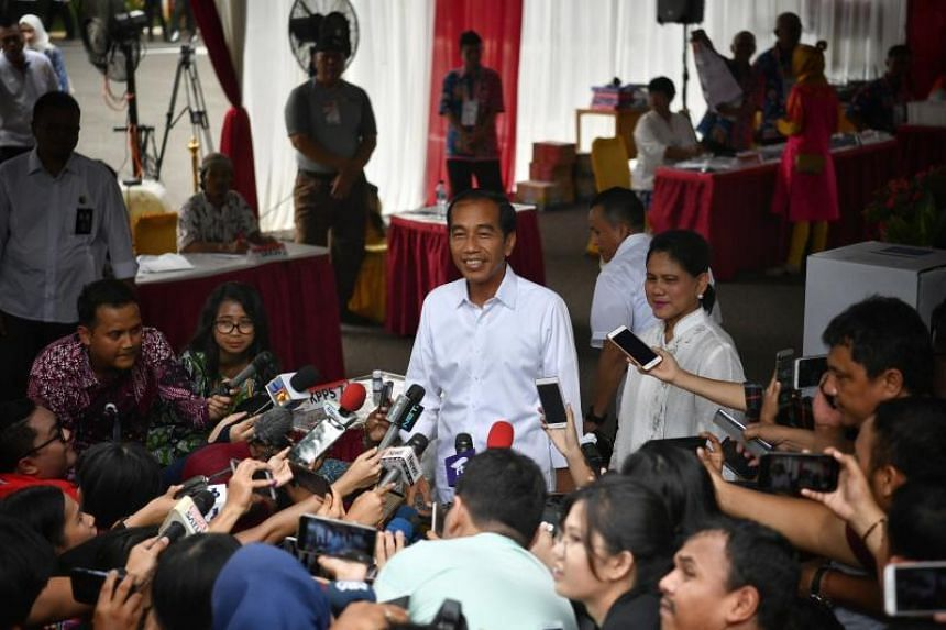 Indonesia's president Joko Widodo speaking to the press after voting at a polling station in Gambir, Jakarta on April 17, 2019.