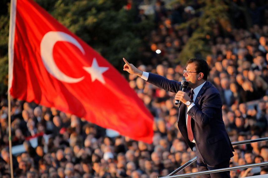 Newly elected Mayor of Istanbul Ekrem Imamoglu addresses his supporters outside the City Hall in Istanbul.