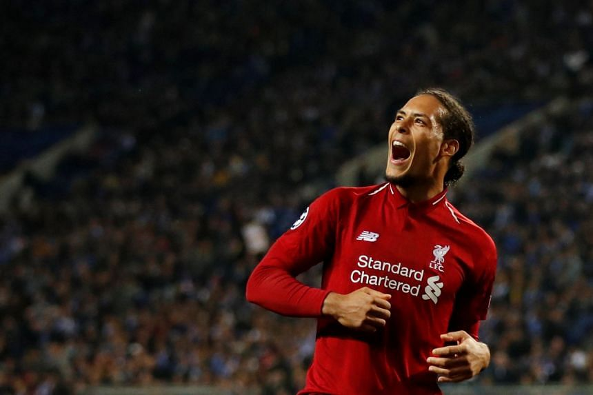 Virgil van Dijk celebrates scoring a fourth goal for Liverpool against Porto.