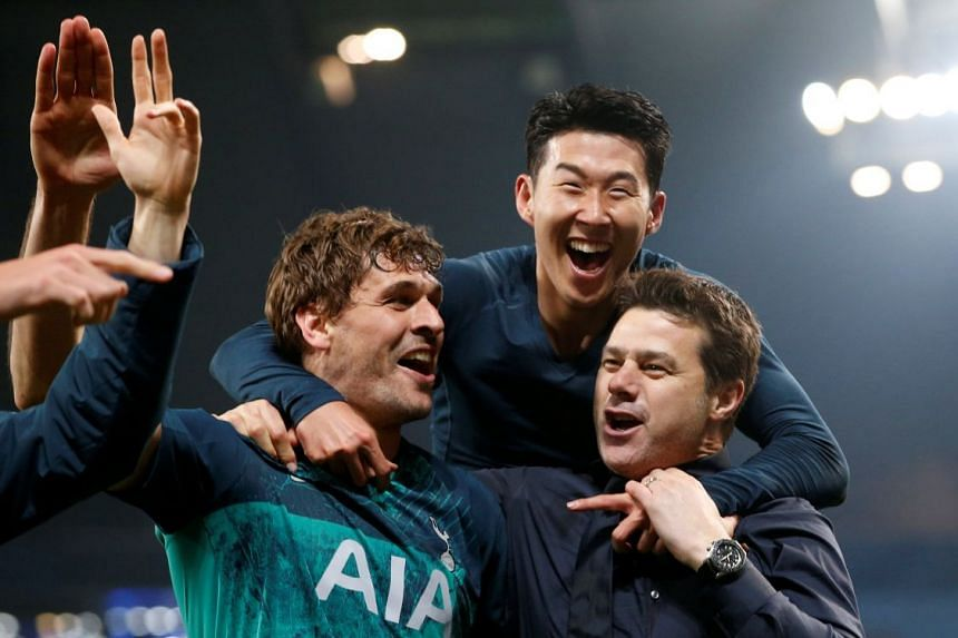 Pochettino celebrates after the match with Tottenham's Fernando Llorente and Son Heung-min.