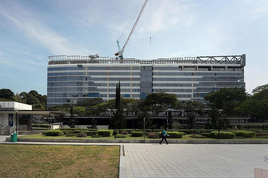 UBS Singapore will take up 381,000 sq ft of net lettable area at the redeveloped Park Mall building, spanning eight levels across two towers. It plans to move into the 10-storey Grade A office building in the second half of next year.