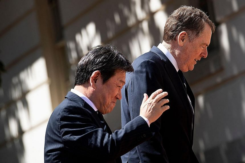 Japanese Economy Minister Toshimitsu Motegi and US Trade Representative Robert Lighthizer in Washington on Tuesday. Mr Motegi says he will be back in the US next week for another meeting with Mr Lighthizer. PHOTO: AGENCE FRANCE-PRESSE