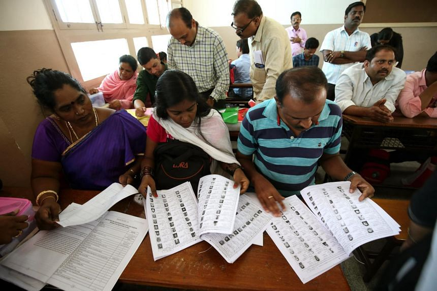 Polling staff conduct checks ahead of the second phase of elections at a polling centre in Bangalore, India on April 17, 2019.