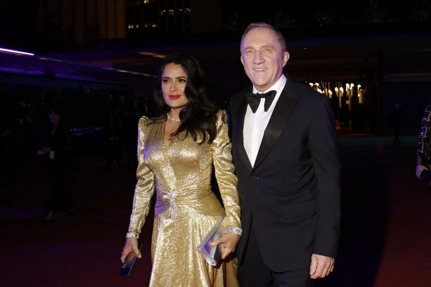 François-Henri Pinault, France's second-richest man, with his wife Salma Hayek at a gala in November 2018. Hayek has defended her spouse against claims that he made donations to the Notre-Dame Cathedral to earn a tax break.