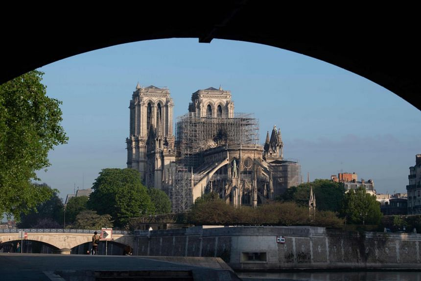 Thet Notre-Dame Cathedral from a bank of the river Seine, in the aftermath of a fire that devastated the place of worship, on April 17, 2019.