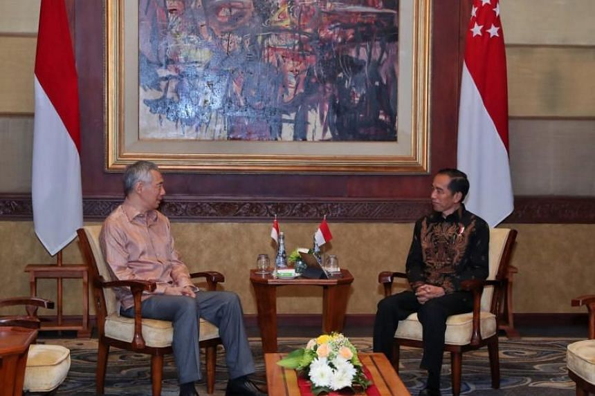 Prime Minister Lee Hsien Loong meeting Indonesian President Joko Widodo at a retreat in Bali in October 2018.