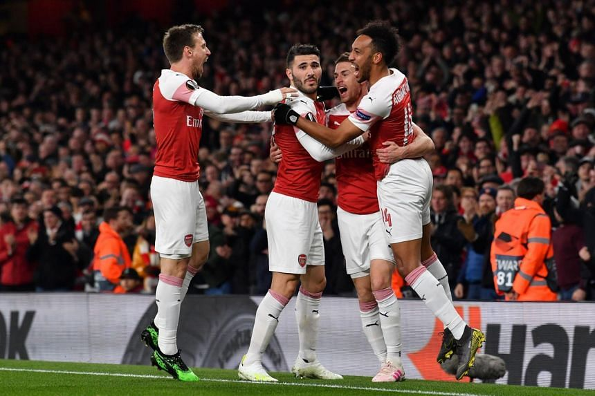 Arsenal players celebrate during the UEFA Europa League match against Napoli at the Emirates Stadium, on April 11, 2019.