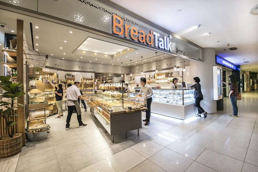 Customers and staff at a BreadTalk outlet in Singapore.
